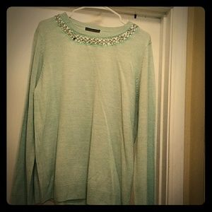 Light green colored sweater